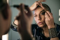 Russian drag queen getting ready Stock Images