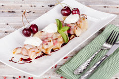 Russian dumplings with cherries Royalty Free Stock Photography