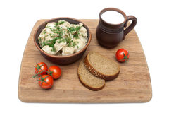 Russian dumplings in a clay bowl on a cutting board. white backg Royalty Free Stock Image