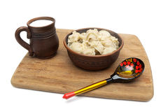 Russian dumplings and a mug with milk on a white background Royalty Free Stock Photos