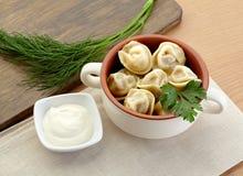 Russian dumplings - pelmeni, in orange bowl. *with mustard Stock Photography
