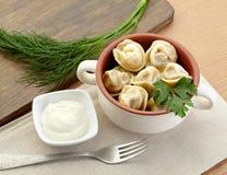 Russian dumplings - pelmeni, in orange bowl. *with mustard Royalty Free Stock Photography