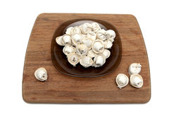 Russian dumplings in a plate on a chopping board. Royalty Free Stock Photos