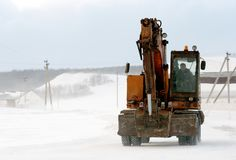 Russian Earthmover Crane in Snow stock images