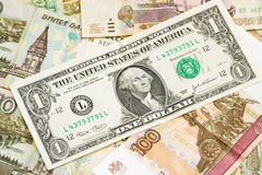 Russian economic crisis: currency rate ruble to dollar. Currency exhange concept. American one dollar on russian money background Stock Images