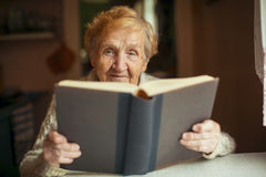 Russian elderly woman reading a book. Education. Stock Images