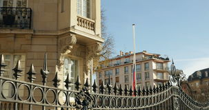 Russian embassy flag half-mast to pay tribute. STRASBOURG, FRANCE - NOV 14, 2015: Russian embassy flag half-mast to pay tribute to the victims of the attacks in stock video