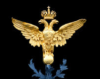 Russian emblem. Bronze Double-headed eagle - Emblem of Russian Empire on the gates of Winter Palace stock images