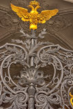 Russian empire symbol. Symbol of russian empire at Hermitage State Museum wrought iron gate stock images