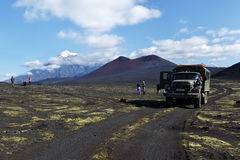 Russian extreme expedition truck 6-wheel drive on mountain roa. TOLBACHIK VOLCANO, KAMCHATKA PENINSULA, RUSSIA - AUG 27, 2014: Russian extreme off-road Royalty Free Stock Photo