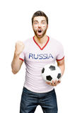 Russian fan holding a soccer ball celebrates on white background Royalty Free Stock Photo
