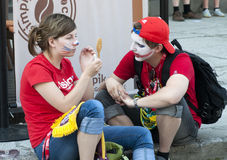 Russian fans make face painting Stock Photography