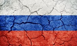 Russian Federation flag. On dry earth ground texture background royalty free stock photos