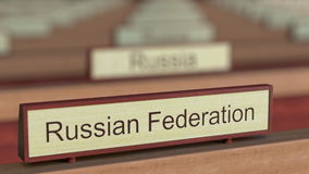 Russian Federation name sign among different countries plaques at international organization. 3D rendering Stock Photos