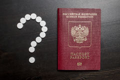 Russian Federation passport and medical pills in form of questio Stock Photo