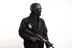 Russian Federation Police officer. Holding an AK47 rifle safely with the finger away from the trigger royalty free stock photo