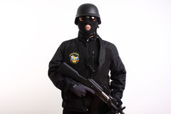 Russian Federation Police officer. Holding an AK47 rifle safely with the finger away from the trigger royalty free stock photography