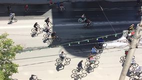 Russian Federation, Respublic of Bashkortostan, Ufa. May 2019. Lot of cyclists ride cycling bike, bicycle parade by city street Ts. Urupi. Crowd of people on stock video footage