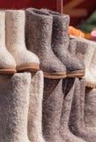 Russian felt boots on market stand closeup Stock Photos