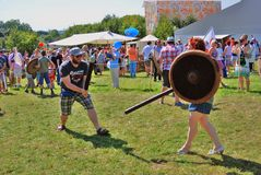Russian field festival in Tsaritsyno park. Man and woman fight for fun. Stock Photos