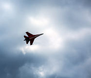 Russian fighter aircraft in cloudy sky Stock Image