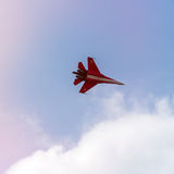 Russian fighter aircraft in cloudy sky Royalty Free Stock Image