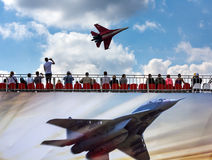 Russian fighter aircraft and spectators in the stands Stock Images