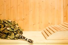 Russian or finnish sauna broom and headrest in wooden sauna. Steam bath with broom hot steam.  stock photography