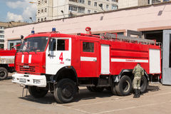 Russian Fireman Working on a Kamaz Fire Vehicle Royalty Free Stock Image