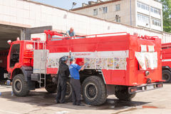 Russian Firemen Working on a Kamaz Fire Vehicle Stock Photography