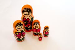 Russian Five Some. A group of five Matryoshka nesting dolls from Russia look like a happy family from fairy tale land Stock Photos