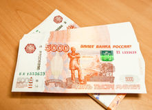 Russian five thousand rubels banknotes on the table. Royalty Free Stock Photos