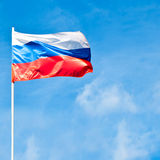 Russian flag. Russian national flag against the blue sky royalty free stock images