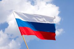 Russian flag. On a background blue sky Stock Photography