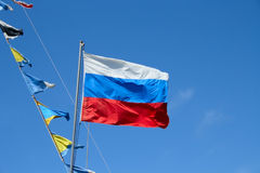 Russian flag. On ship on blue sky background royalty free stock photo