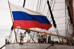 Russian flag. Crew onboard of Russian tallship with Russian flag Stock Photography