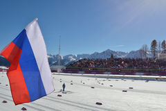 Russian flag against ski stadium in Sochi Stock Photography