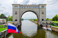 Russian flag on background of arch of navigation lock, Uglich Stock Image