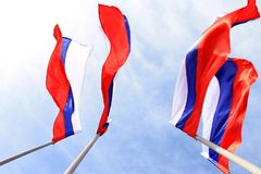 Russian flag on a background blue sky royalty free stock image