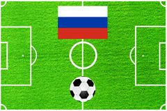 Russian flag on the background of a football field Stock Photos