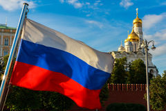 Russian flag on the background of the Kremlin, Archangel Cathedral in the Moscow Kremlin. Royalty Free Stock Image