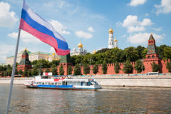 Russian flag on background of Moscow Kremlin and Moscow River Stock Photos