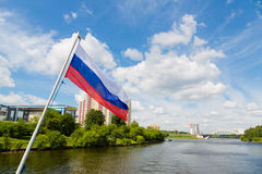 Russian flag on the background of the suburbs of Moscow Royalty Free Stock Images