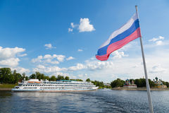 Russian flag on the background of the town of Uglich. Russian flag on the background of the historic town of Uglich. Embankment of the Volga River stock photo