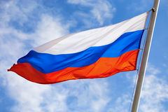 Russian flag. Beautiful waving flag of Russia on sky background Stock Photography
