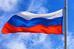 Russian flag. Beautiful waving flag of Russia on sky background Royalty Free Stock Image