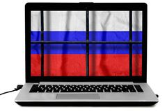 Russian flag behind black metal bars of a grate on the computer screen. Isolated on white background. Symbol of the law about disconnecting the Russian Internet stock photo