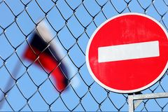 Russian flag behind a metal fence. With a sign is forbidden royalty free stock photography