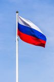 Russian flag. On the blue sky Stock Photography