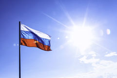 Russian flag on blue sky background Royalty Free Stock Photography